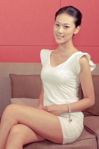 gorgeous_chinese_model_sitting_on_a_sofa_6759436597